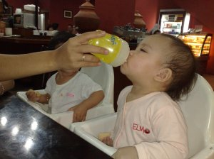 Afya can't get enough of Luna's avent sippy cup